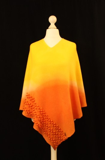 Solasonach Ripples lambswool poncho in dip dyed sunshine