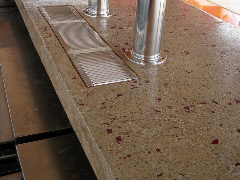 polished concrete countertop closeup with drink rail
