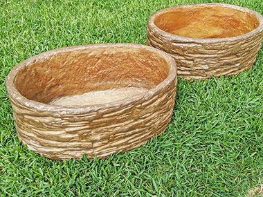 oval shaped stone textured concrete planter