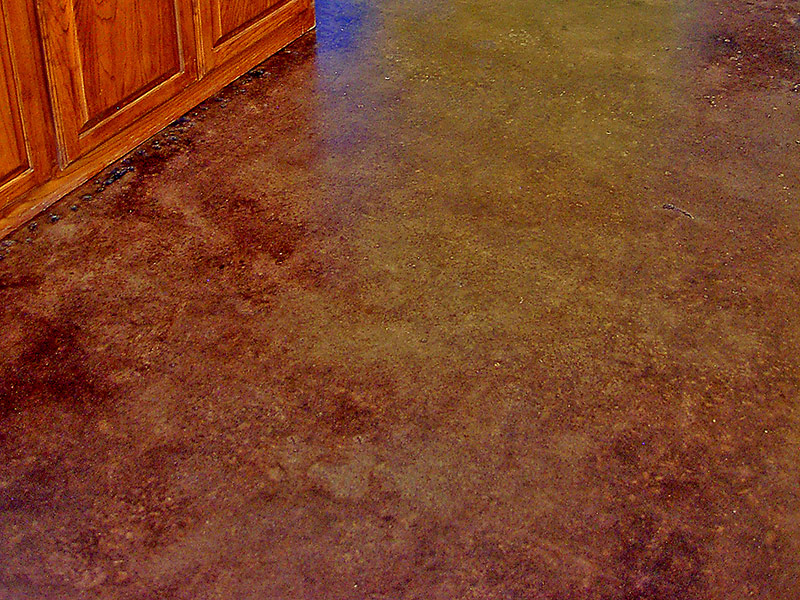 brown acid stained floor and cabinet