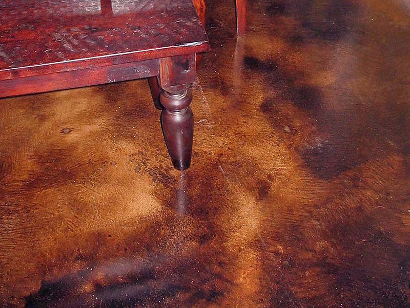 table leg on brown acid stained floor