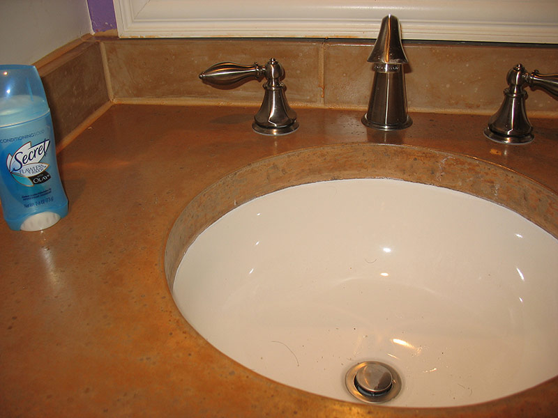 closeup of undermount sink in concrete bathroom countertop