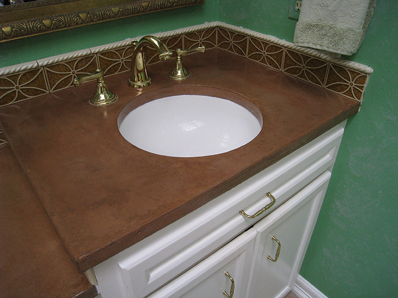 view of undermount sink in concrete bathroom countertop