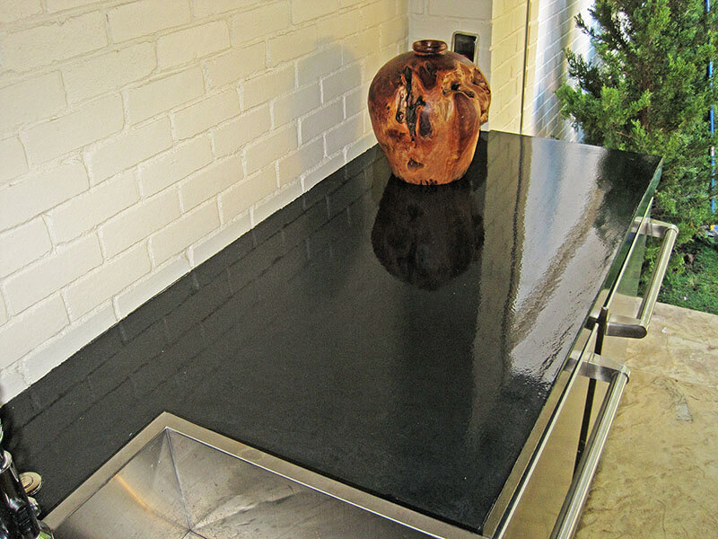vase reflected off finish on black concrete countertops