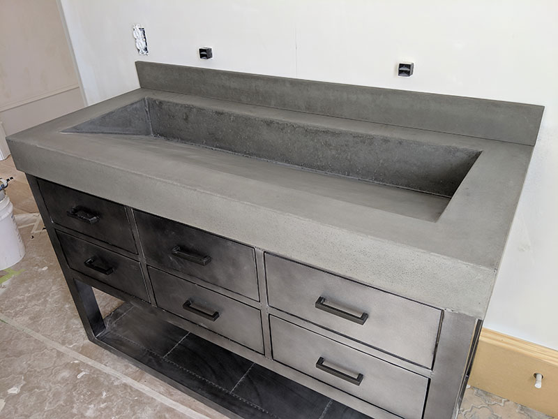 anbled view of ramp style concrete sink in a home