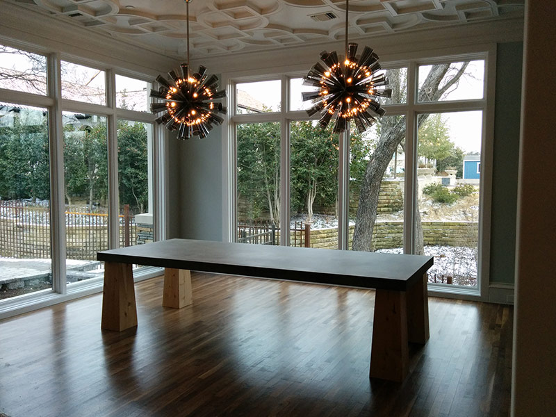 hanging lamps over concrete table