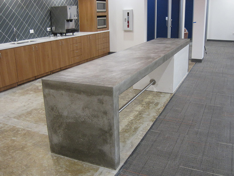cement table with waterfall edge