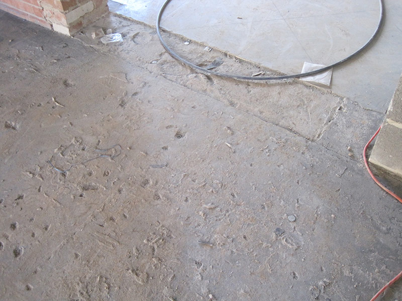 chipped up concrete floor