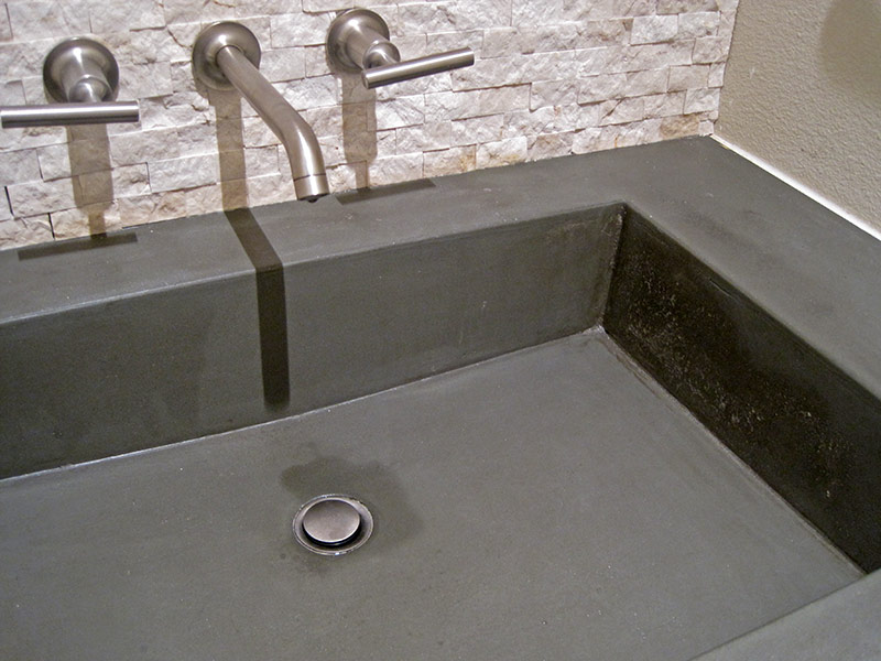 close up of integral concrete bathroom sink