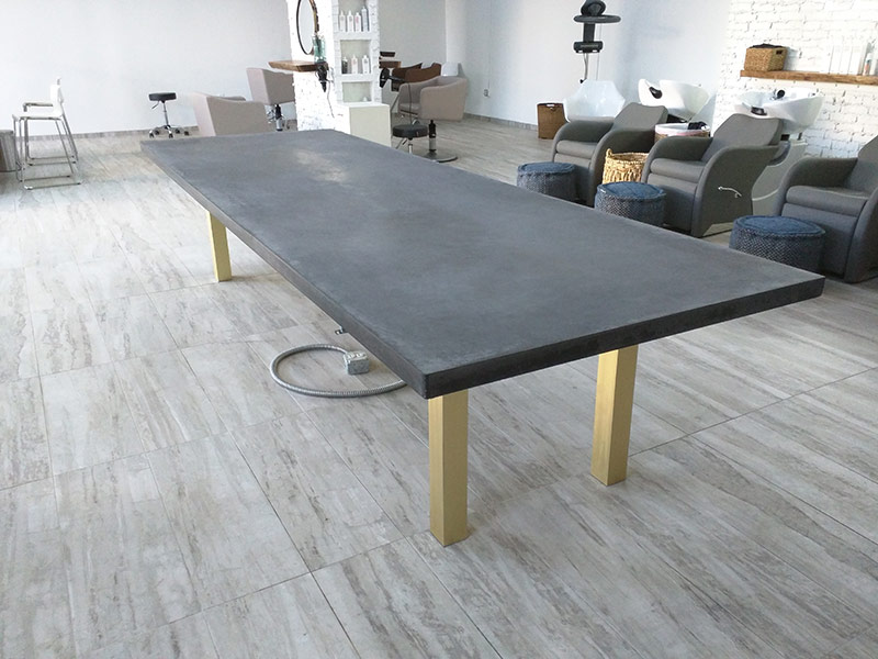 alternate view of gray concrete conference table