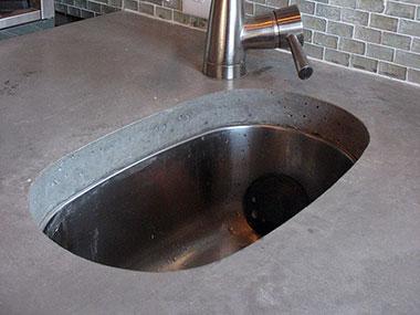 undermounted prep sink in a concrete countertop