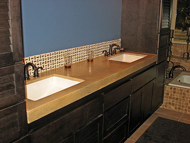 beige colored concrete countertop with two white undermount sinks