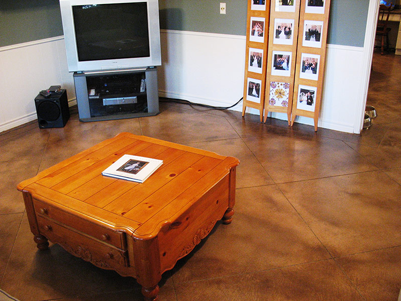microfinish overlay floor with coffee table on it