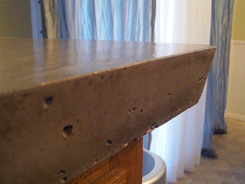 angled edge of concrete countertop