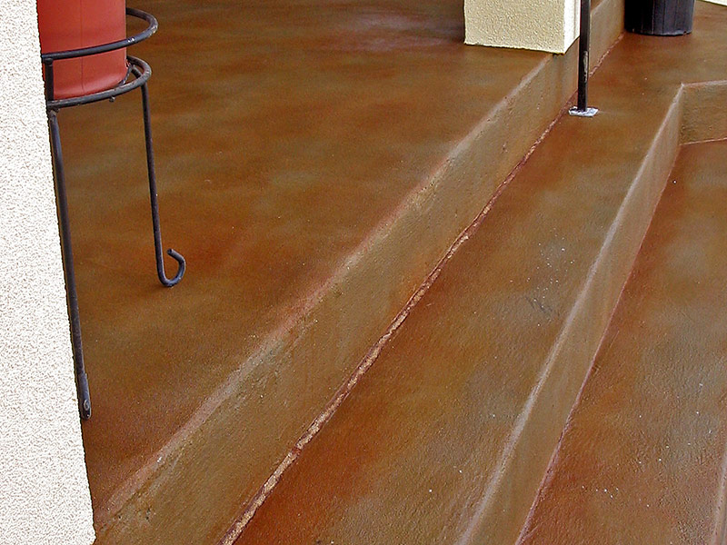 steps leading up to stained concrete porch