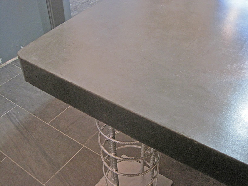 closeup of edge of gray concrete conference table