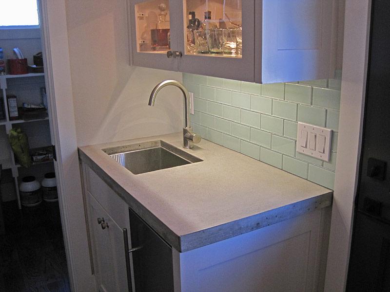 butler cabinet with gray concrete countertop
