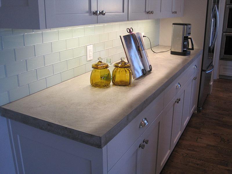 gray concrete countertop with jars