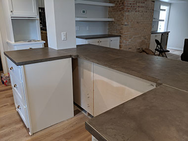 side view of dark gray concrete countertops