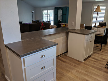 front view of dark gray concrete countertops