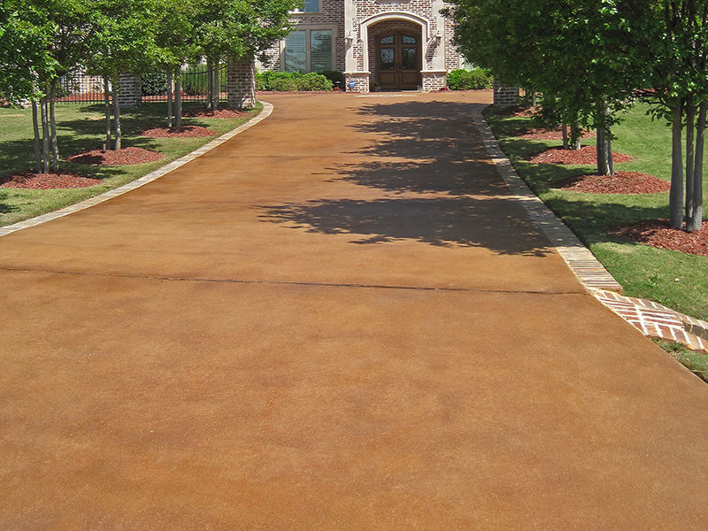 umber acid stained driveway