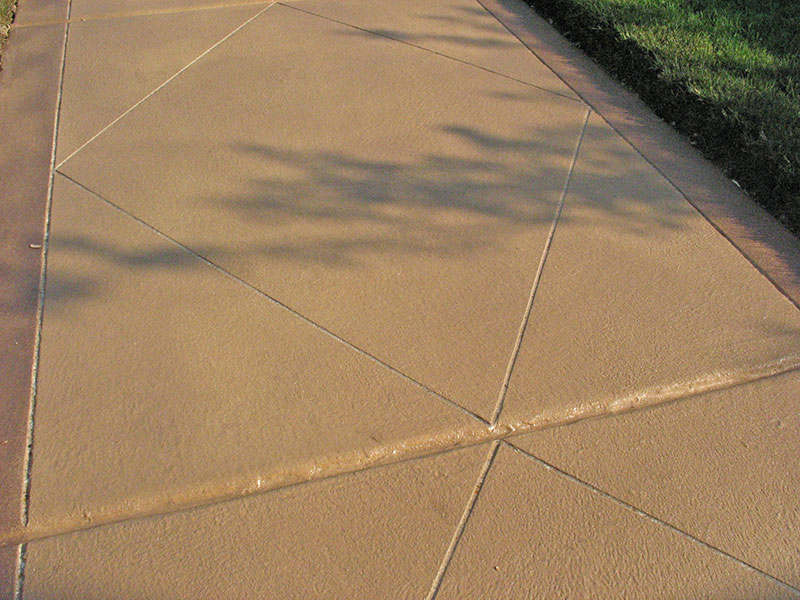 close up of skim coated sidewalk with score marks