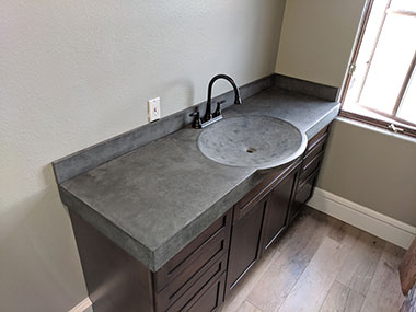 green slate colored concrete countertop with integrated sink