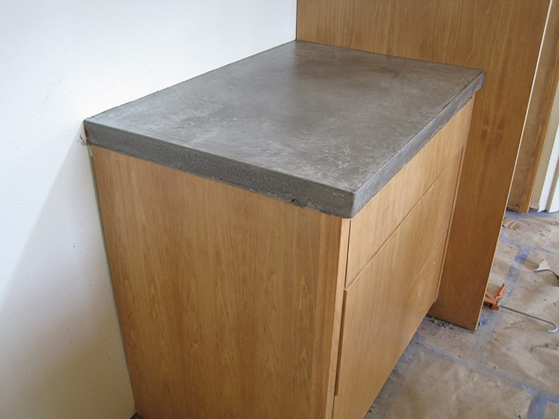 gray concrete countertop on a cabinet