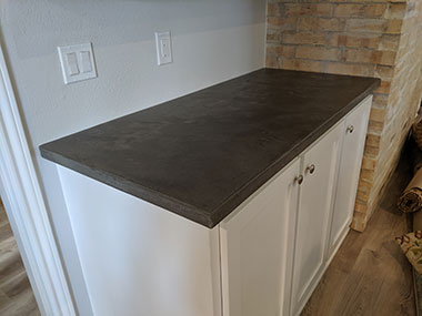 installed dark gray concrete countertop