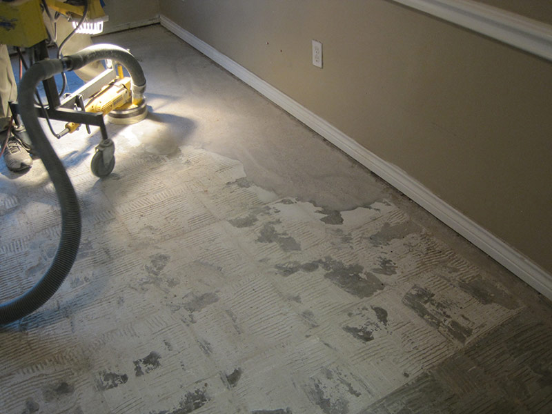 bare concrete floor after removing tiles