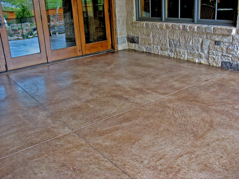 kona brown stained patio featuring glass doors