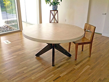 white round concrete dining table