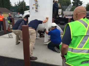 Installing propane tanks at Solid Ground Transportation