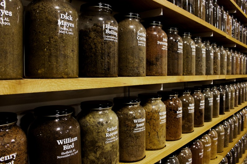 Dirt collections from several lynching sites labeled with the names of victims at EJI