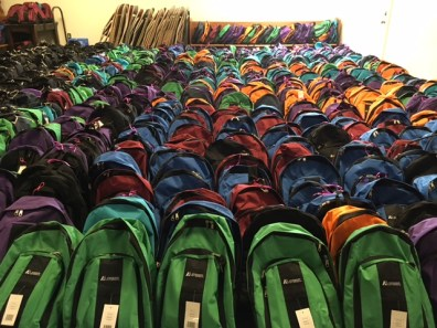 Colorful backpacks lined up and ready to go.