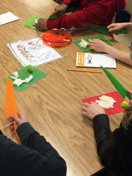 4th & 5th graders use their tools to cut Jicamas to make takis.