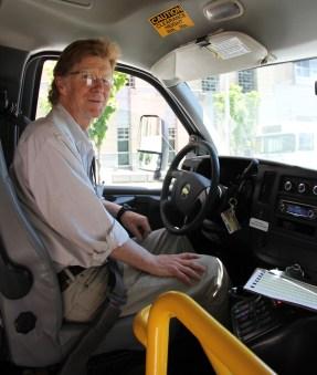 Driver Joe McCrea takes the wheel (photo by Lara Breitkreutz)