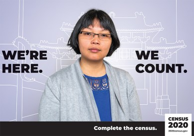 """US Census poster picturing a woman w/ the text: """"We're here, we count."""""""