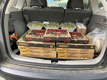 Pizza boxes ready for the donation