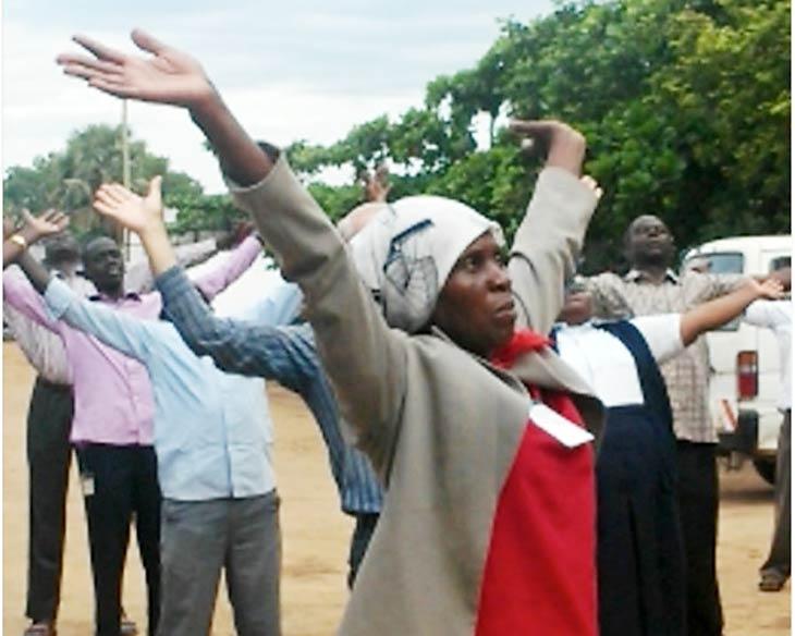 South Sudanese praying