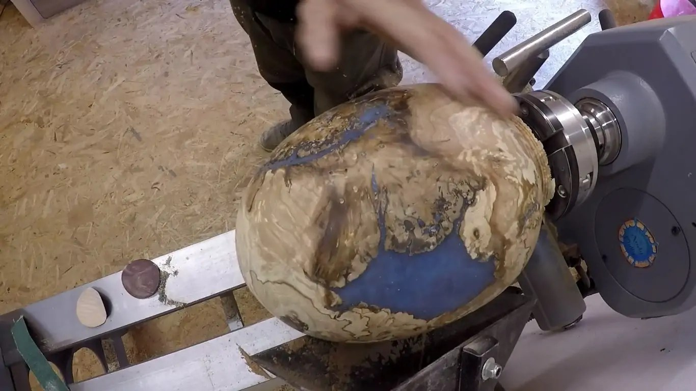 Watch A Woodworker Transform A Burl Into A Dragon Egg On The Lathe