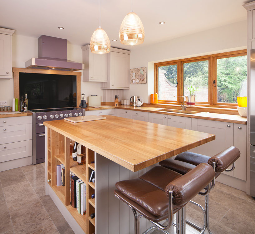 The counter top used was a speckled gray and black solid surface material. New Kitchen Designs for 2018: Our Guide to the Latest Trends - Solid Wood Kitchen Cabinets
