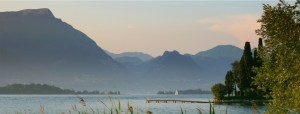 Peaceful landscape of lake and mountains in the background
