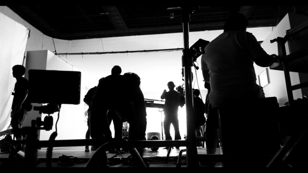 silhoutte-images-of-video-production-and-lighting-set-for-filming-which-movie-crew-team-working-and_t20_gRj7AY