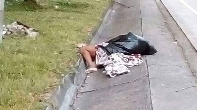 Localizan cadáver envuelto en sabanas y dentro de una bolsa en carretera Los Chorros