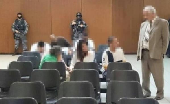 Policías, civiles y militares ligados a grupo de exterminio fueron enviados a prisión temporal