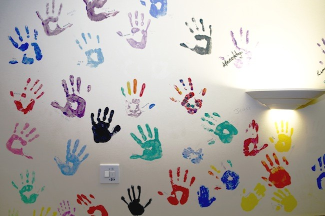 Little Havens Hospice handprints on wall