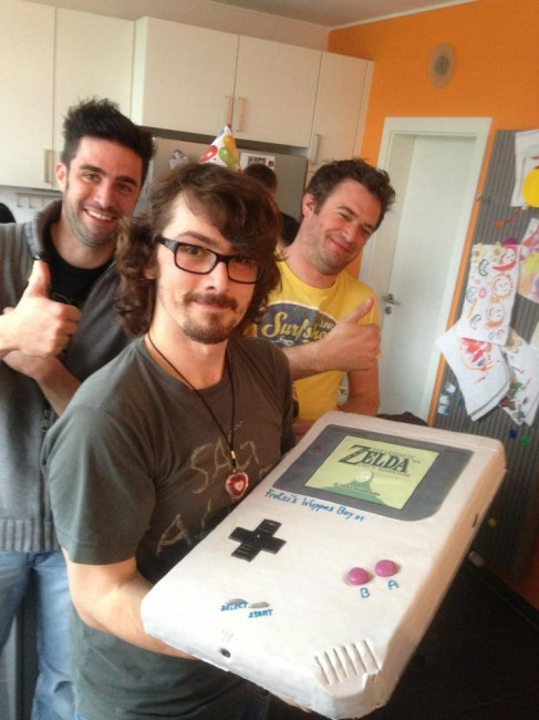 Wuppes holding giant Game Boy cake