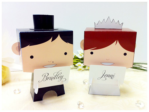 Cute paper craft bride and groom figures to go on top of a cake.