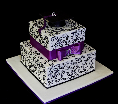 graduation cake with a purple bow